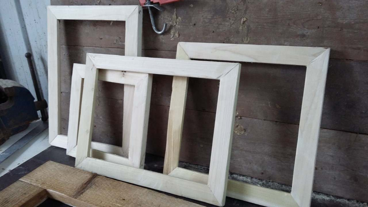 a group of rustic wooden picture frames
